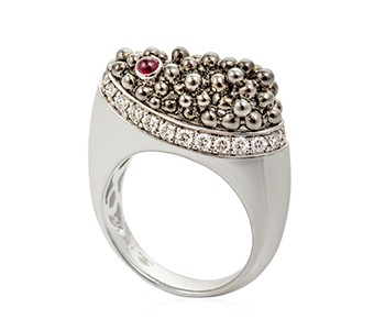Caviar, diamonds, ruby, white gold everywhere, apart from the black beads on the top section of the ring, which are black gold1