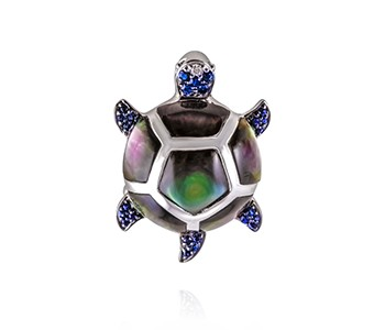 Turtle, paua shell, sapphire, diamond, white gold everywhere, apart from the tail,leg and part of the head section with the blue stones, which are in black